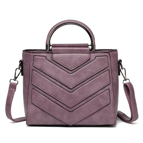 products/Chevron-Top-Handle-Grained-Leather-Handbag-Lilac-Colour-Image-1.jpg