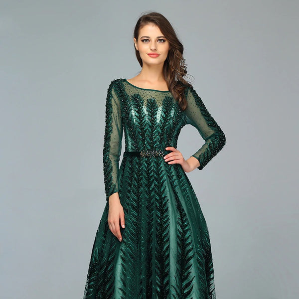 "<p style=""font-size: 18px;""><b>CIARA</b></p><p style=""color:grey"">CRYSTAL LEAF EMBELLISHED A-LINE GOWN-EMERALD</p>"