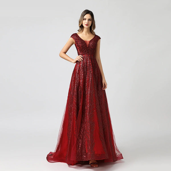 "<p style=""font-size: 18px;""><b>CIARA</b></p><p style=""color:grey"">CRYSTAL LEAF EMBELLISHED A-LINE GOWN-RED</p>"