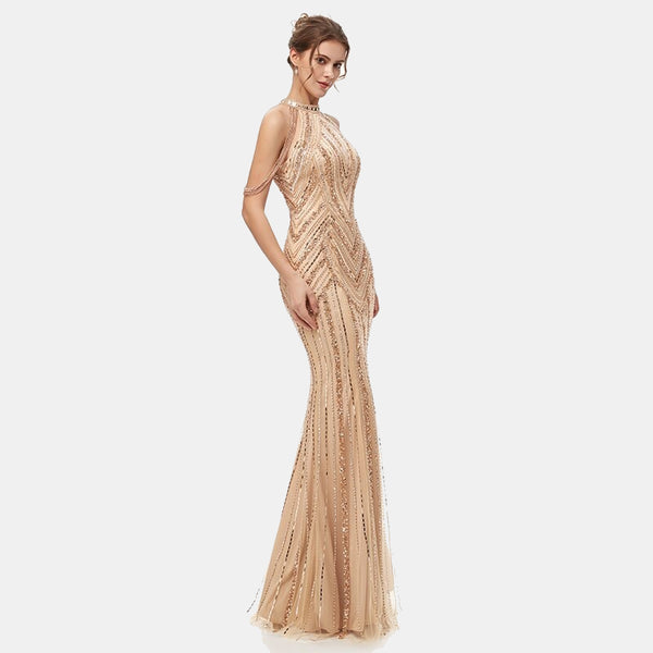 "<p style=""font-size: 18px;""><b>CLEOPATRA</b></p><p style=""color:grey"">GOLD TASSELLED CRYSTAL BEADED MERMAID GOWN</p>"