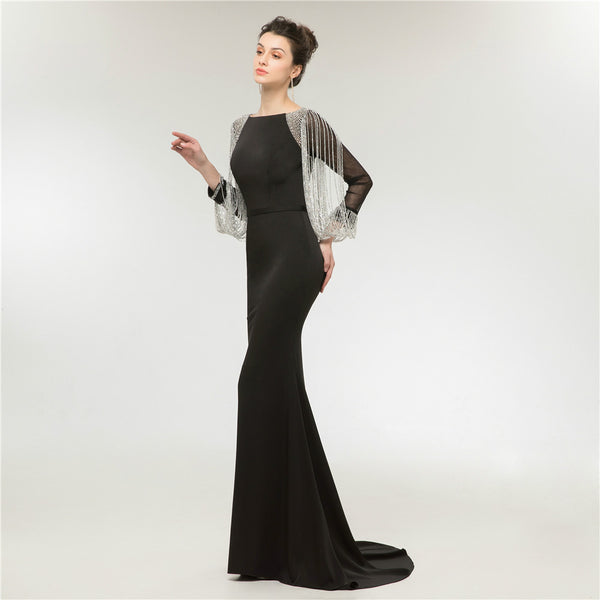 "<p style=""font-size: 18px;""><b>CLEOPATRA</b></p><p style=""color:grey"">CRYSTAL TASSELLED SHEER SLEEVED MERMAID GOWN</p>"