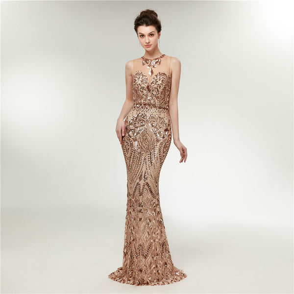 "<p style=""font-size: 18px;""><b>CRYSTAL ALLURE</b></p><p style=""color:grey"">ROSE GOLD SEQUIN EMBELLISHED MERMAID GOWN</p>"