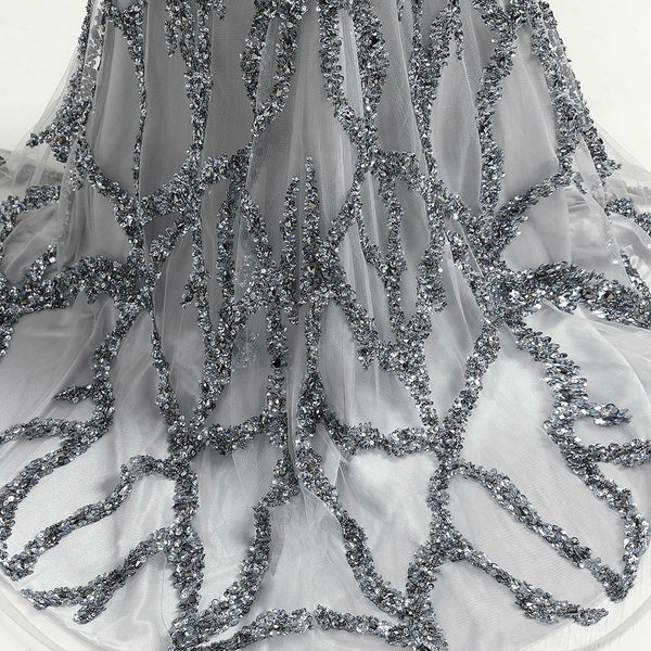 "<p><p style=""font-size:18px""><b>CRYSTAL SHIMMER</b></p><p style=""color:grey"">MULTI WEB BEADED MERMAID GOWN</p>"