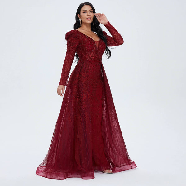 "<p style=""font-size: 18px;""><b>DEMOISELLE</b></p><p style=""color:grey"">WINE RED CRYSTAL BEADED ORGANZA CAPE GOWN</p>"