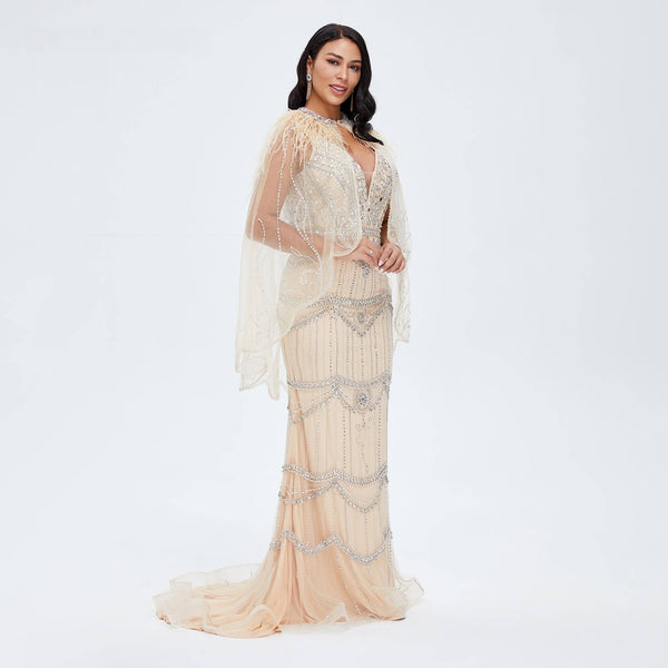 "<p style=""font-size: 18px;""><b>ELOISE</b></p><p style=""color:grey"">CHAMPAGNE FEATHER & CRYSTAL BEADED CAPE GOWN</p>"