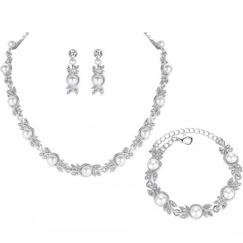 products/Enchanted-Pearl-_-Rhinestone-Crystal-Leaf-Branch-Necklace-Earrings-Bracelet-Set-Image-1.jpg