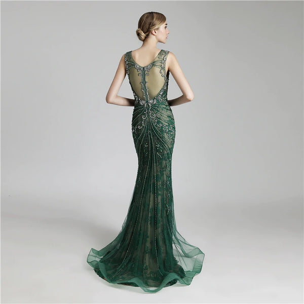 "<p style=""font-size: 18px;""><b>GATSBY</b></p><p style=""color:grey"">EMBELLISHED GOWN WITH CRYSTAL NECKLACE-EMERALD</p>"