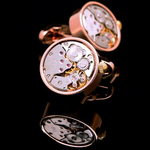 Gear Movement Winding Cufflinks In Rose Gold Colour Featuring A Mechanical Gear Design In Round Shaped Casing And Crown With Manual Wind Mechanism