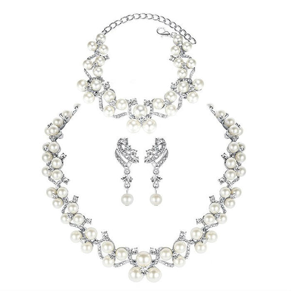 <p><b>PEARLESQUE</b><br><p>Cream Pearl & Rhinestone Necklace, Earrings & Bracelet Set</p>