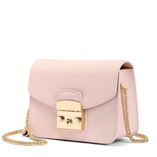 <p><b>INDULGE</b><br><p>Genuine Leather Riveted Crossbody Bag</p>