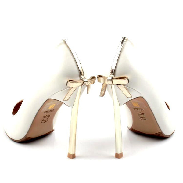 <p><b>INDULGENCE</b><br><p>Ivory Bridal Occasion Gold Ribbon Court Heels</p>