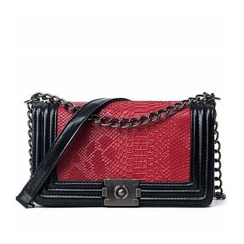 products/Indulgence-Python-Pattern-Shoulder-Bag-Messenger-Style-Handbag-In-Black-Leather-With-Red-Python-Pattern-And-Polished-Chain-Image-1.jpg