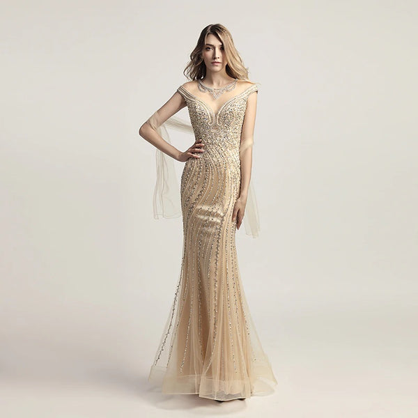 "<p style=""font-size: 18px;""><b>LAKISHA</b></p><p style=""color:grey"">GOLD MULTI BEADED GOWN W. NECKLACE DETAIL</p>"