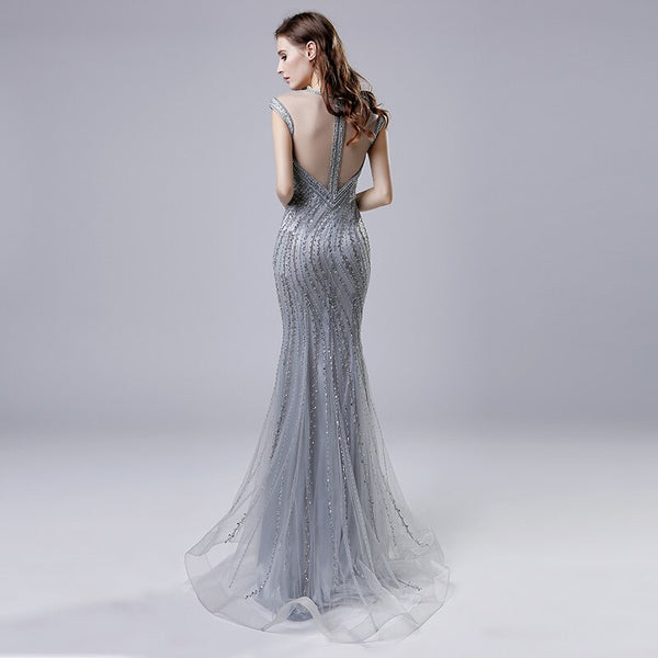 "<p style=""font-size: 18px;""><b>LAKISHA</b></p><p style=""color:grey"">GREY MULTI BEADED GOWN W. NECKLACE DETAIL</p>"