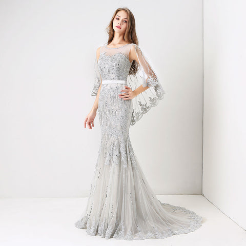 products/Quintessa-Crystal-_-Bead-Embellished-Flutter-Sleeve-Tulle-Gown-1.jpg