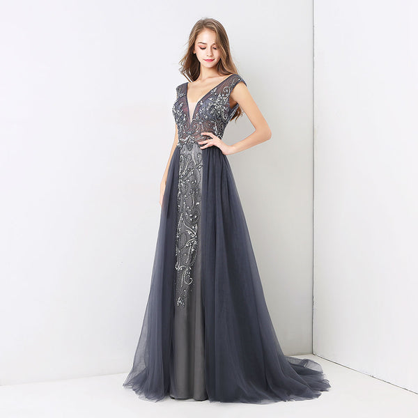 "<p style=""font-size: 18px;""><b>SEDUCTION</b></p><p style=""color:grey"">CRYSTAL BEADED BACKLESS CAPE GOWN</p>"