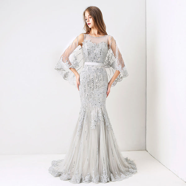 "<p style=""font-size: 18px;""><b>QUINTESSA</b></p><p style=""color:grey"">MULTI BEADED SHOULDER CAPE MERMAID GOWN</p>"