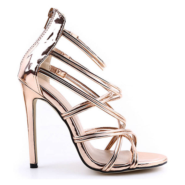 <p><b>SEDUCTIVE</b><br><p>Rose Gold Patent Leather Multi Strap Heels</p>