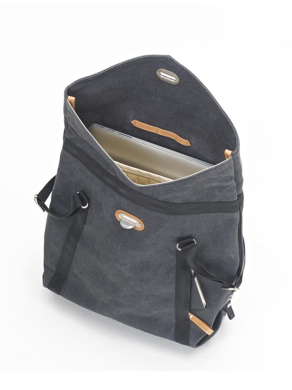 "A 15"" laptop fits into the internal sleeve of Qwstion Tote bag/backpack"