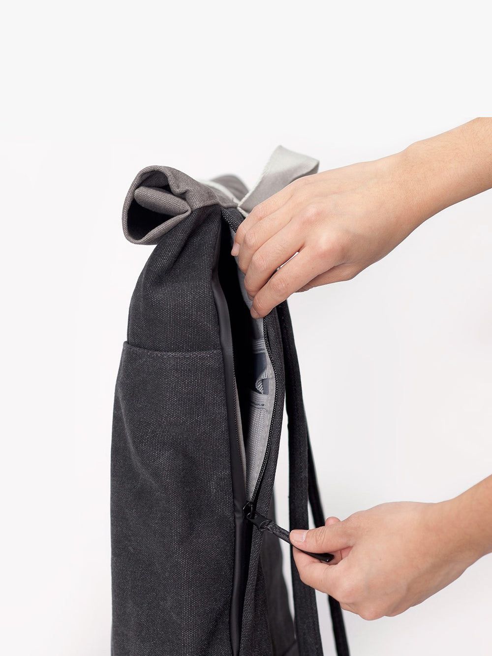 A side zip allows access to the main compartment of Hajo Backpack