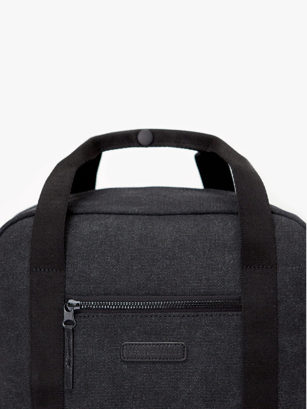 Ison backpack top handle and zipped pocket.