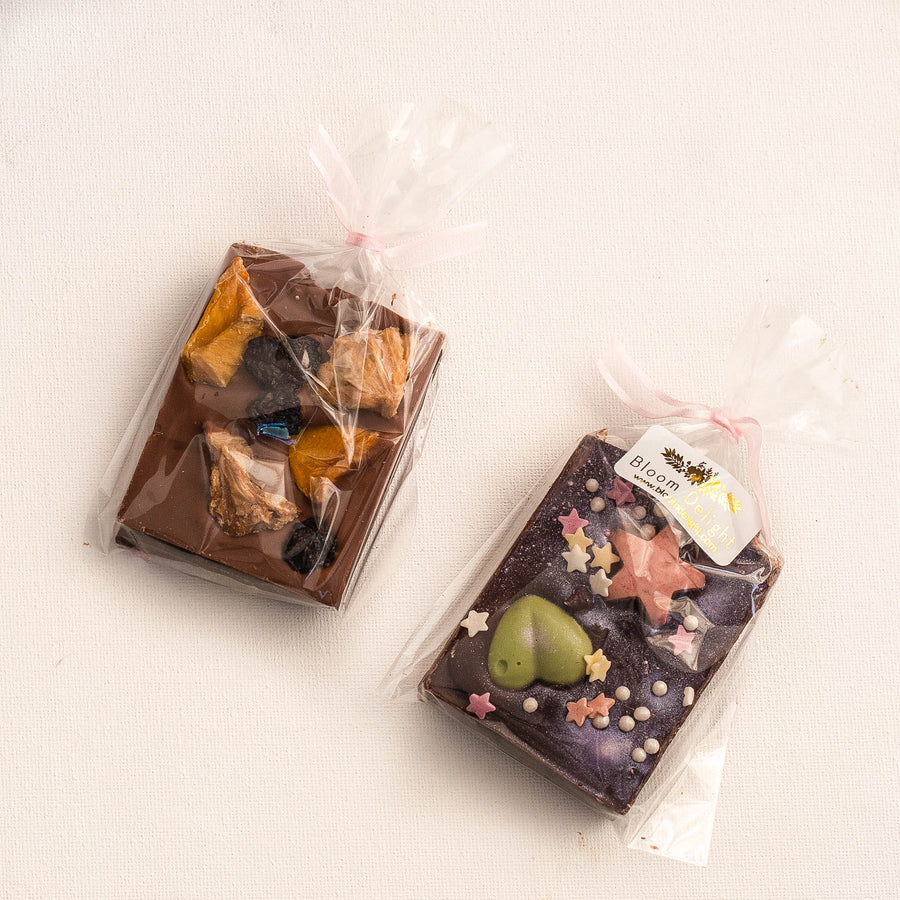 bloom delight dark and milk chocolate selection with matcha tea and nuts