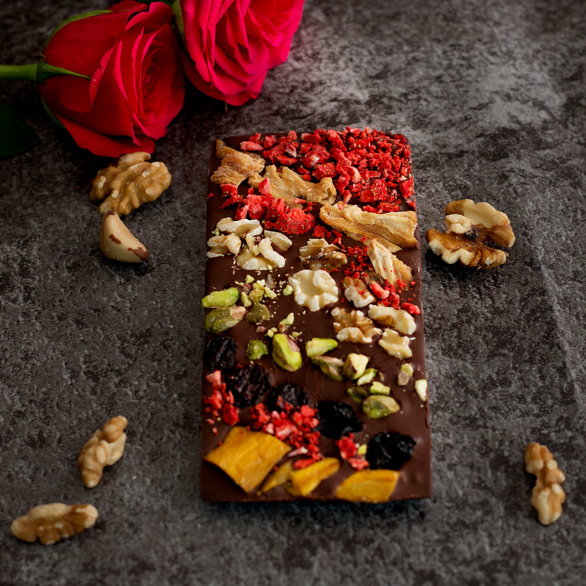 Bloom Delight healthy superfood chocolate bar with dried fruits and nuts.