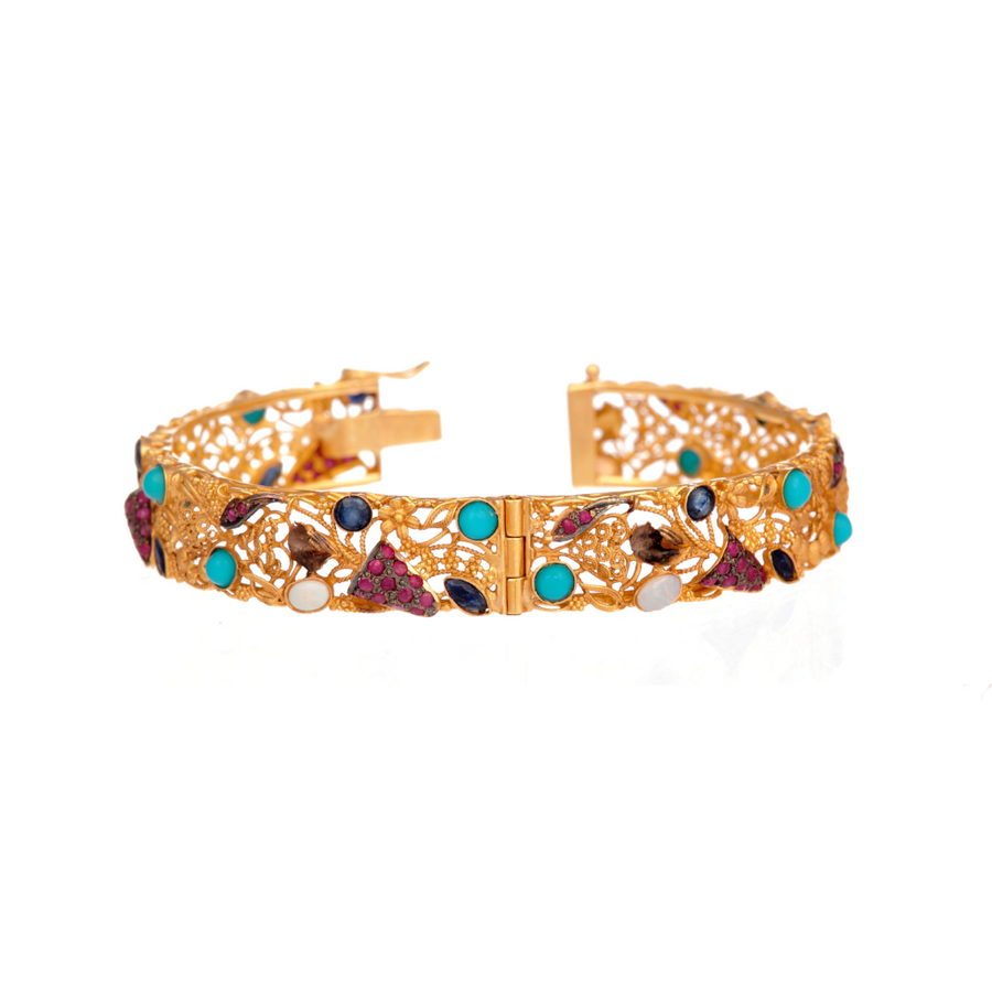 Intricate Kara studded with Turquoise, Rubies, Sapphires, and Opals made in 22k gold