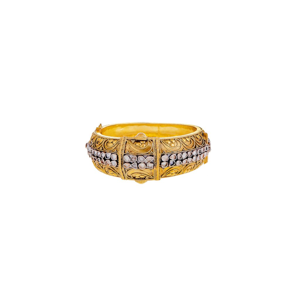 Trendsetting kara, handmade with filigree work and studded with Cubic Zirconia made in 22k gold