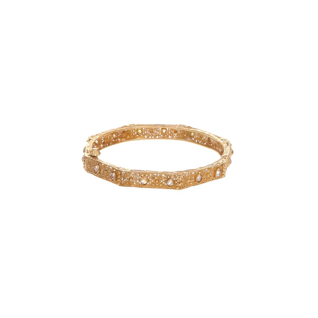 Dainty Kara with matte gold finish and studded with cubic zirconia made in 22k gold
