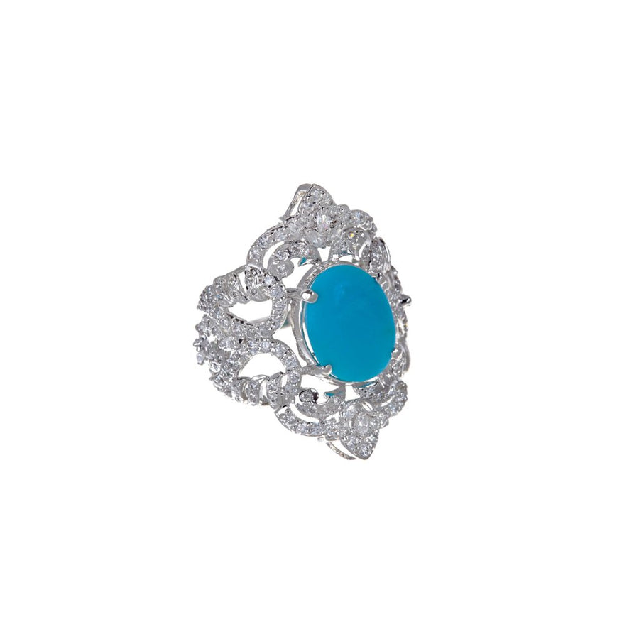 Handmade 22k gold Cubic Zirconia ring with an Turquoise center stone finished in Rhodium