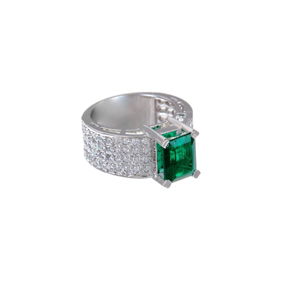 Handmade 22 karat gold cubic zirconia ring with an Emerald center stone.