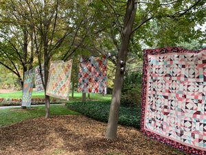 Quilts Hanging in the Trees