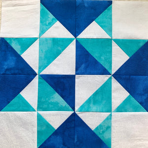 Wild Geese Quilt Block Tutorial - quilt block in blue, teal, and white