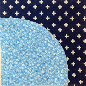 Sewing Curved Quilt Pieces - blue curved quilt piece sewn together
