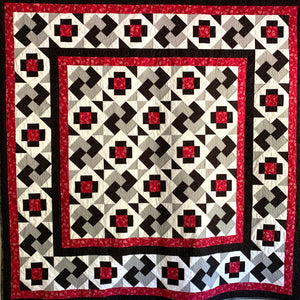 The Not So Tricky Quilt in Red, Grey, black, and white with Greek cross and card trick blocks