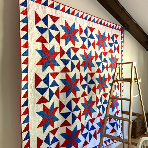 Hanging a Quilt on a Wall Using a Curtain Rod