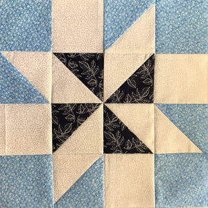 Meteor Quilt Block Free Tutorial - quilt block in light blue, blue, and white.