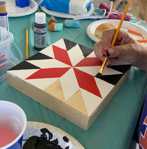 Making a Barn Quilt of Painted Quilt Block - hand painting a red, black and white quilt pattern on a wooden block