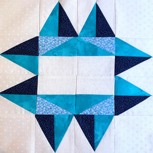 Utah Star Quilt Block with 8 points in blue, teal, and white.