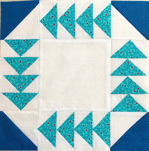 Fox and Geese Quilt Block. Featuring teal flying geese and navy blue half square triangles