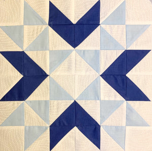 Wyoming Valley Quilt Block made of Blue and White Half Square Triangles.