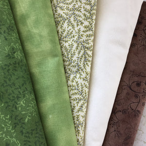 Fabric selection for the Irish Woodland quilt in Green and Brown