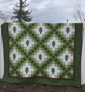 Irish Woodland Quilt in Green Brown and White with tiny trees on a irish chain.