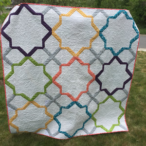 Moroccan Lullaby Quilt in white and light colors. Pattern by Melissa Corry