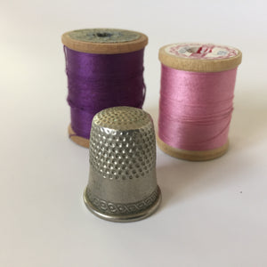 Antique Metal Thimble with Antique Thread