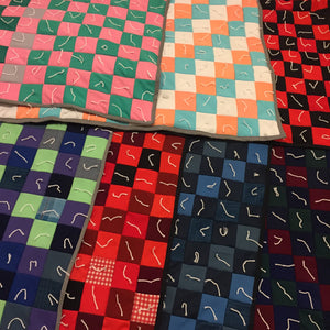 Seven polyester throw quilts