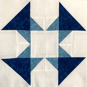 Dandy Quilt Block made in blue and white with triangles