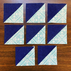 Eight HSTs at a time - showing 8 half square triangles in blue and teal
