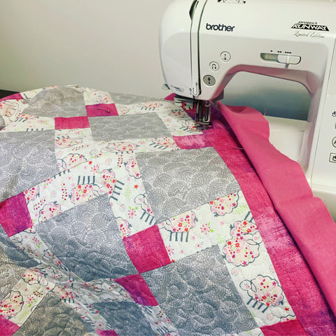 Disappearing Nine Patch quilt at the sewing machine